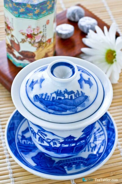 Blue and White Gaiwan with a pattern similar to the Spode Blue Willow pattern. It has a porcelain filter insert suitable for loose leave tea.   TeaTattler.com #gaiwan #liddedbowl