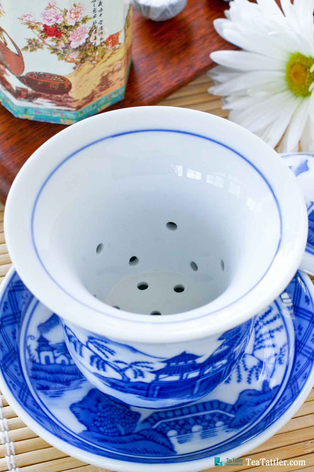 Blue and White Gaiwan with a pattern similar to the Spode Blue Willow pattern. It has a porcelain filter insert suitable for loose leave tea. | TeaTattler.com #gaiwan #liddedbowl