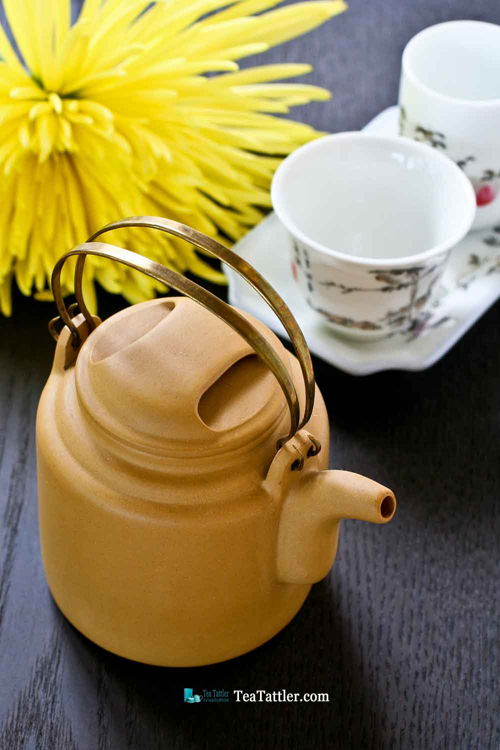 This pretty Brass Handled Yixing Teapot is made with light mustard yellow clay. It measures 2½ inches in diameter and is 2¾ inches in height. | TeaTattler.com #brasshandledteapot #yixingteapot #coppergirderteapot