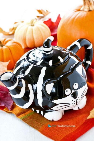 Adorable black and white striped Kitty Teapot named Chester The Cat . The finial is its pointy tail. Perfect for a theme tea party. | TeaTattler.com #kittyteapot #chesterthecat