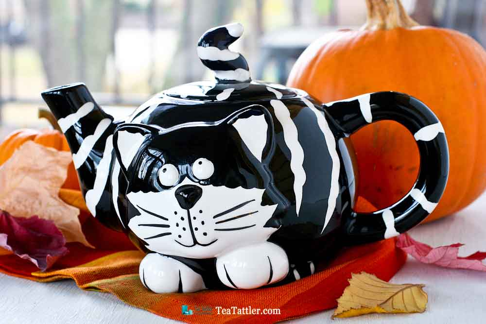 Adorable black and white striped Kitty Teapot named Chester The Cat . The finial is its pointy tail. Perfect for a theme tea party.   TeaTattler.com #kittyteapot #chesterthecat
