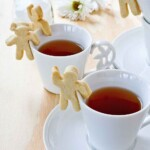 These fun and tasty Cup-Adorning Lemon Cookies are able to cling to the side of your teacup or mug. A delight for all occasions.   TeaTattler.com #cupadorninglemoncookies #lemoncookies