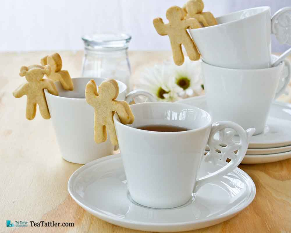 These fun and tasty Cup-Adorning Lemon Cookies are able to cling to the side of your teacup or mug. A delight for all occasions. | TeaTattler.com #cupadorninglemoncookies #lemoncookies