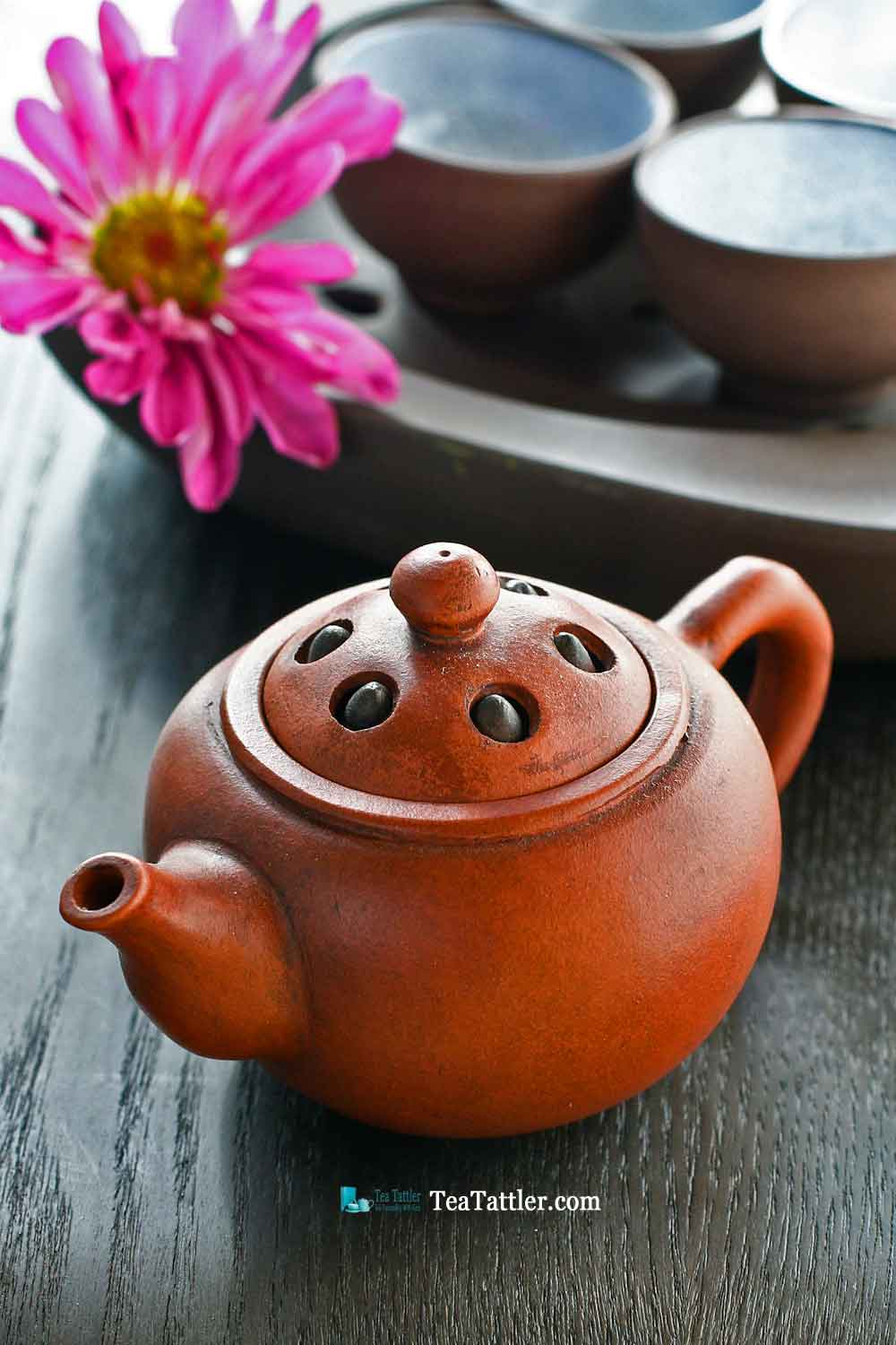 This Yixing Lotus Seed Teapot is made in the classic lotus seed design. The lid has six lotus seeds that move. Size is 4¾ inches by 2 inches. | TeaTattler.com #lotusseedteapot #yixingteapot