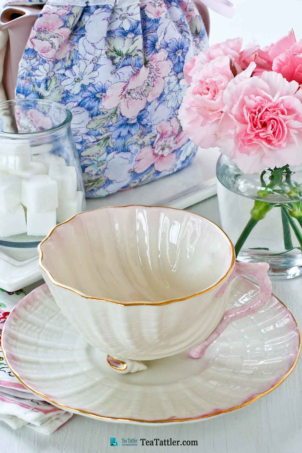 Neptune Seashell, Belleek - a delicate soft pink scooped shell teacup with two tiny conch shell feet and sculptured coral handle. | TeaTattler.com #neptuneseashellteacup #belleek