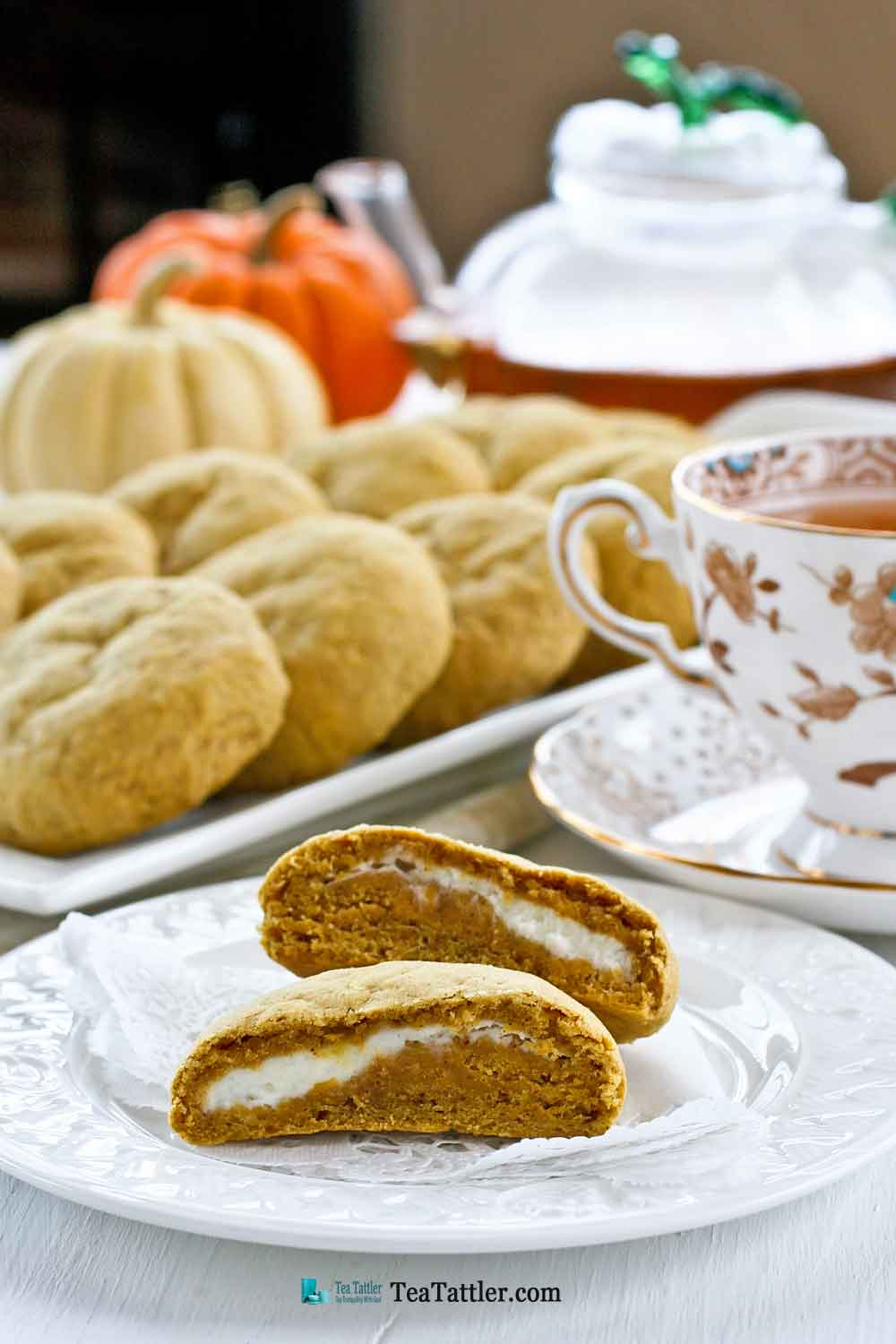 Pumpkin Cream Cheese Cookies - soft and chewy pumpkin flavored cookies with a cream cheese filling and a cake-like texture. | TeaTattler.com #pumpkincookies #creamcheesecookies #filledcookies