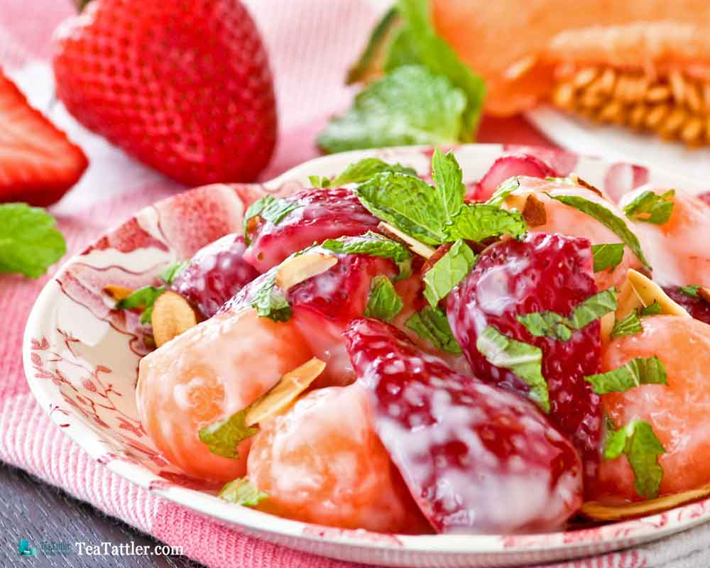 Cantaloupe Strawberry Salad - a cool and refreshing fruit salad using seasonal fruits perfect for a light meal or dessert.   TeaTattler.com #cantaloupestrawberrysalad #cantaloupesalad #strawberrysalad