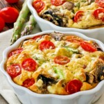 Easy Asparagus Mushroom Crustless Quiche with seasonal vegetables for Mother's Day or any day. Also a delicious brunch idea for the weekends.   TeaTattler.com #asparagusquiche #mushroomquiche #crustlessquiche
